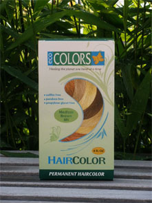 box of EcoColors hair coloring kit set on a green leafy background