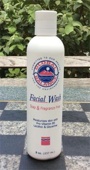 6 oz. bottle of facial wash with green leafy background