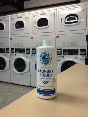 bottle of non-toxic laundry liquid detergent set in a laundry room